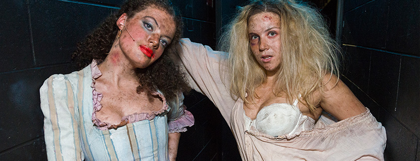 Two Stage and Screen students posing in costume to camera